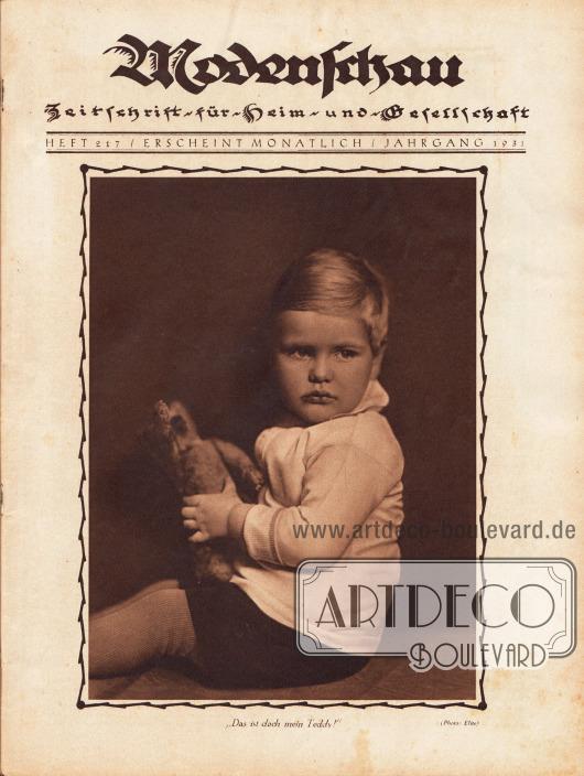 """Titelblatt der Modenschau Nr. 217 mit der großformatigen Fotografie eines etwa 2 bis 3-jährigen Jungen mit Teddy und der Bildunterschrift """"Das ist doch mein Teddy"""". Foto: Elite."""